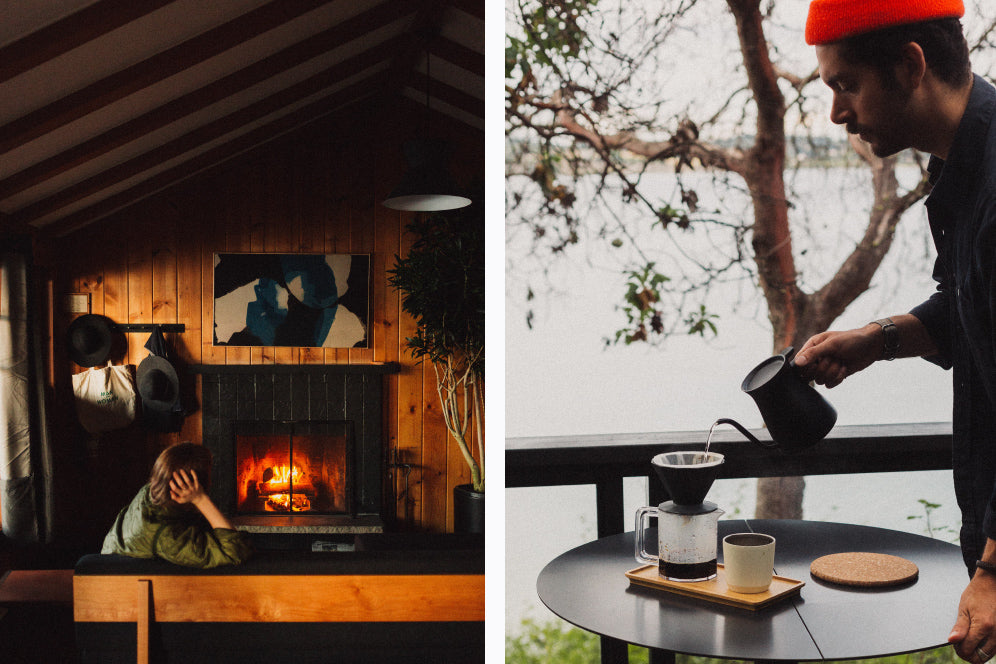 Inside cabin sitting near fireplace and pouring coffee using ALFRESCO coffee brewer