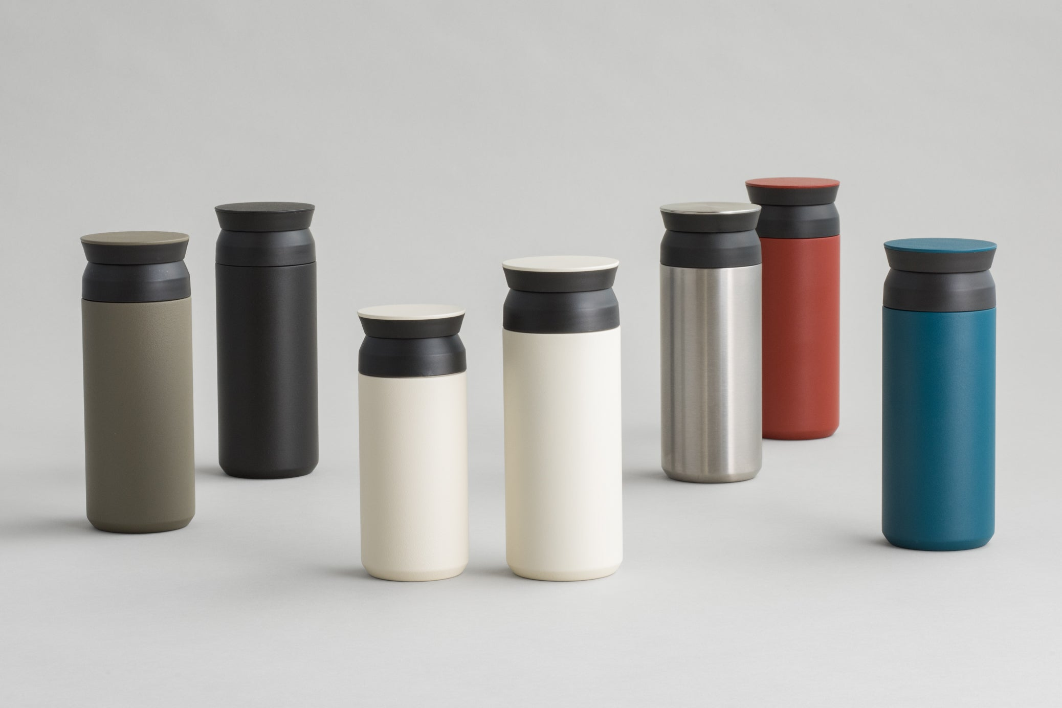 TRAVEL tumbler collection in black, white, red, turquoise, and stainless steel