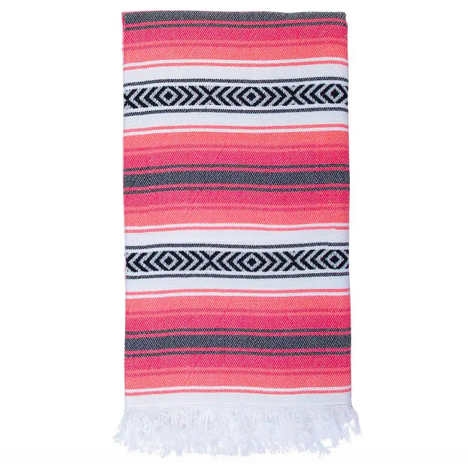 Product image of the Todos Santos Turkish Towel. Color scheme of red, coral, white, and black. White fringe on either end.