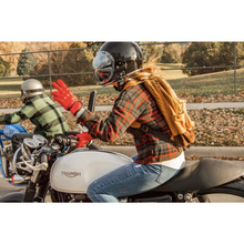 "Load image into Gallery viewer, Close up photo of person riding a motorcycle and doing a peace sign while wearing the 78 Motor Co. ""Speed"" gloves in the color red."