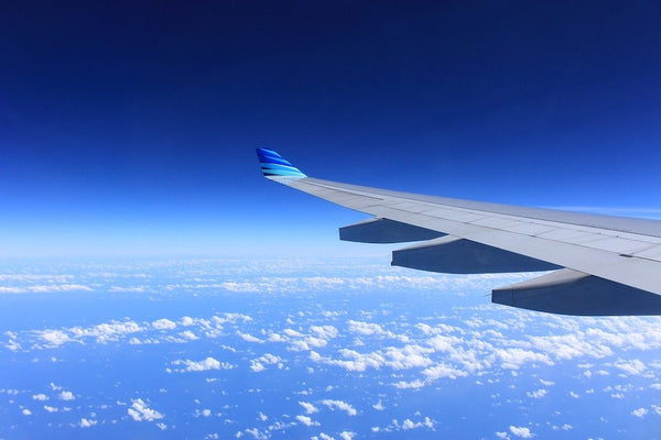 A view of a plane wing from a plane window