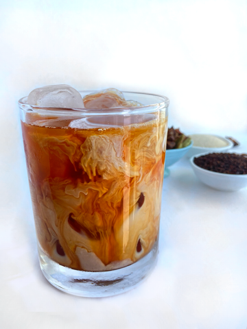 A glass of Shanti Chai & Co's Original Chai Blend, poured over ice.