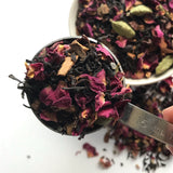 A measured tablespoon of Shanti Chai & Co's Rose Petal Chai, ready to make chai to be iced!