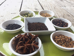 Some of the whole spices that make up masala chai include star anise pods, cinnamon, cardamom, ginger, black peppercorns, cloves and more. This masala is combined with black loose leaf tea, often Assam tea.