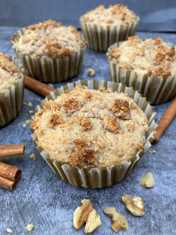 keto cinnamon crumble muffins on dark background