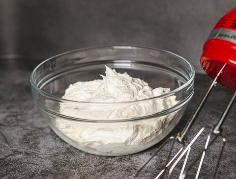 sugar free keto buttercream frosting in bowl with red mixer