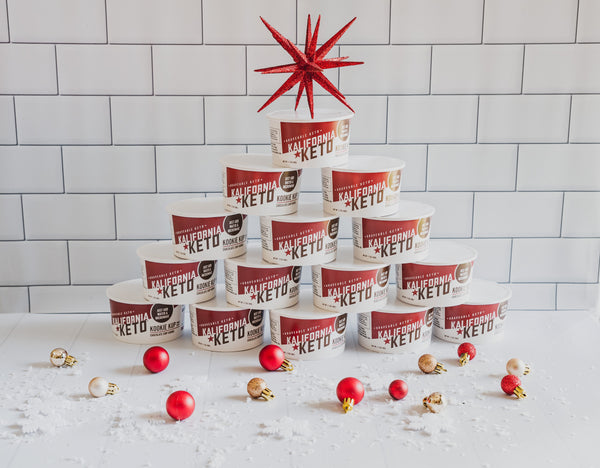 Christmas Tree Made of Keto Cookie Cups Topped with Star and Surrounded by Ornaments