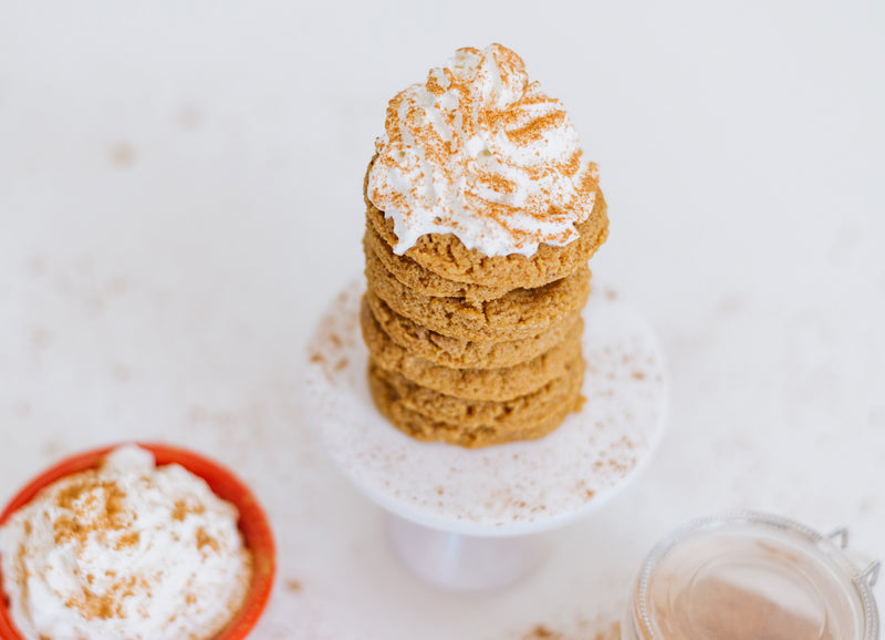 Stack of Keto Pumpkin Spice Cookies Topped with Whipped Cream and Pumpkin Spice