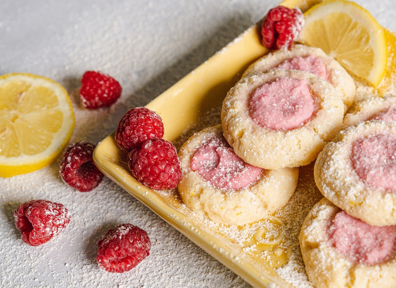 Lemon Raspberry Keto Butter Cookies with Frosting on Yellow Plate