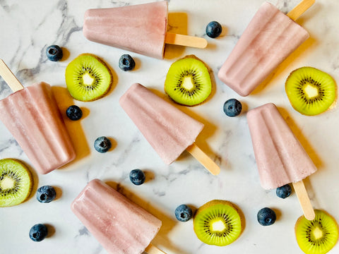 Creamy popsicles with elderberry syrup and coconut milk.