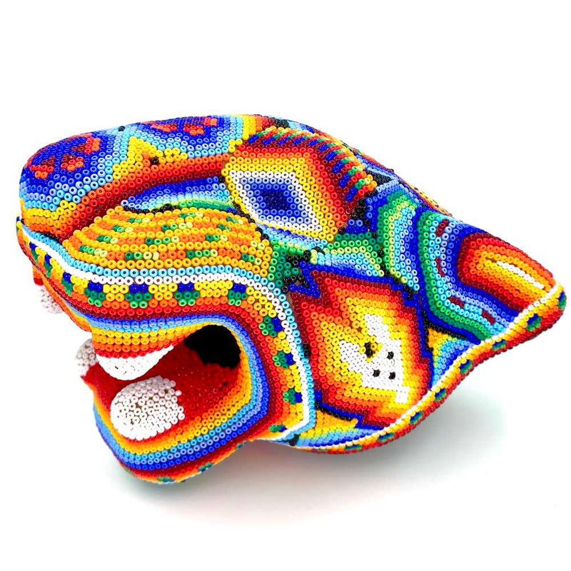 Bright huichol jaguar head