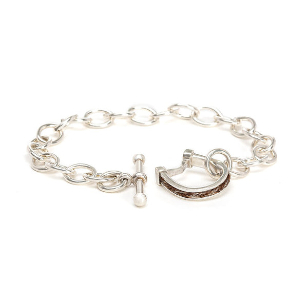 Silver horseshoe toggle bracelet with inset square horsehair braid