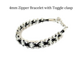 Black and white horsehair zipper bracelet with toggle clasp