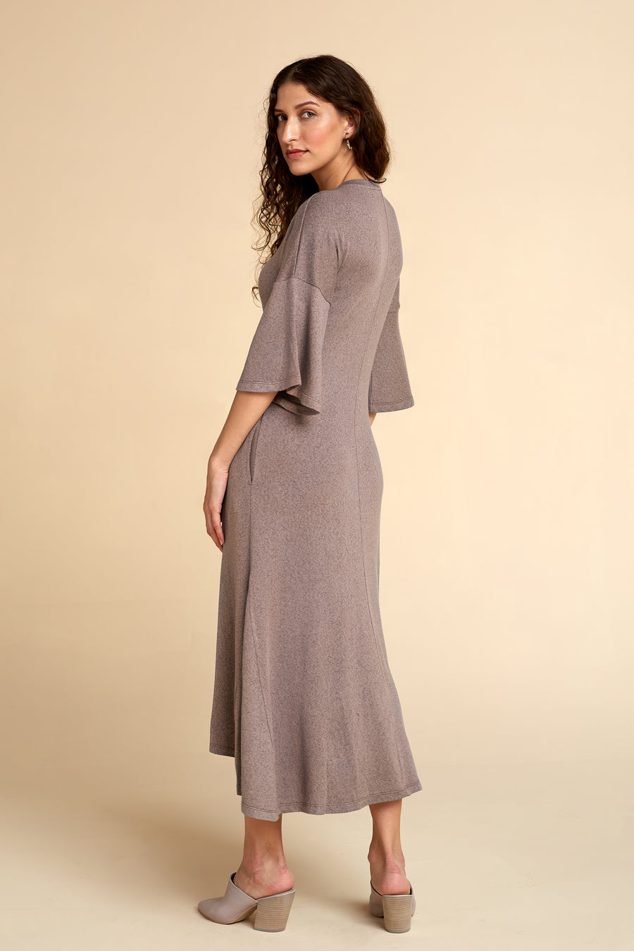 Model wearing Akala Clothing's sustainable Sweater Dress in Mink color, size Extra Small