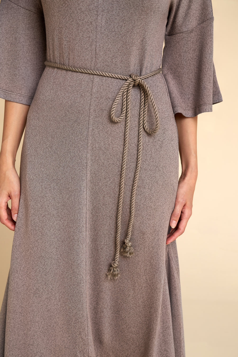 Close up of Akala Clothing's sustainable Sweater Dress with cotton cord in Mink color, size Extra Small