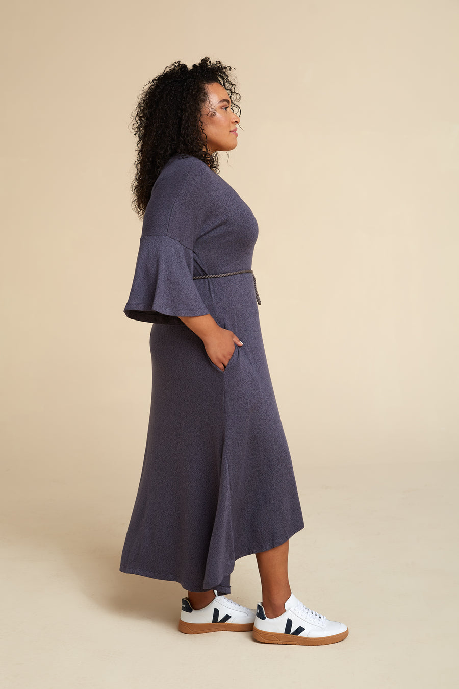 Model wearing Akala Clothing's sustainable Sweater Dress in Dusk color, size Large