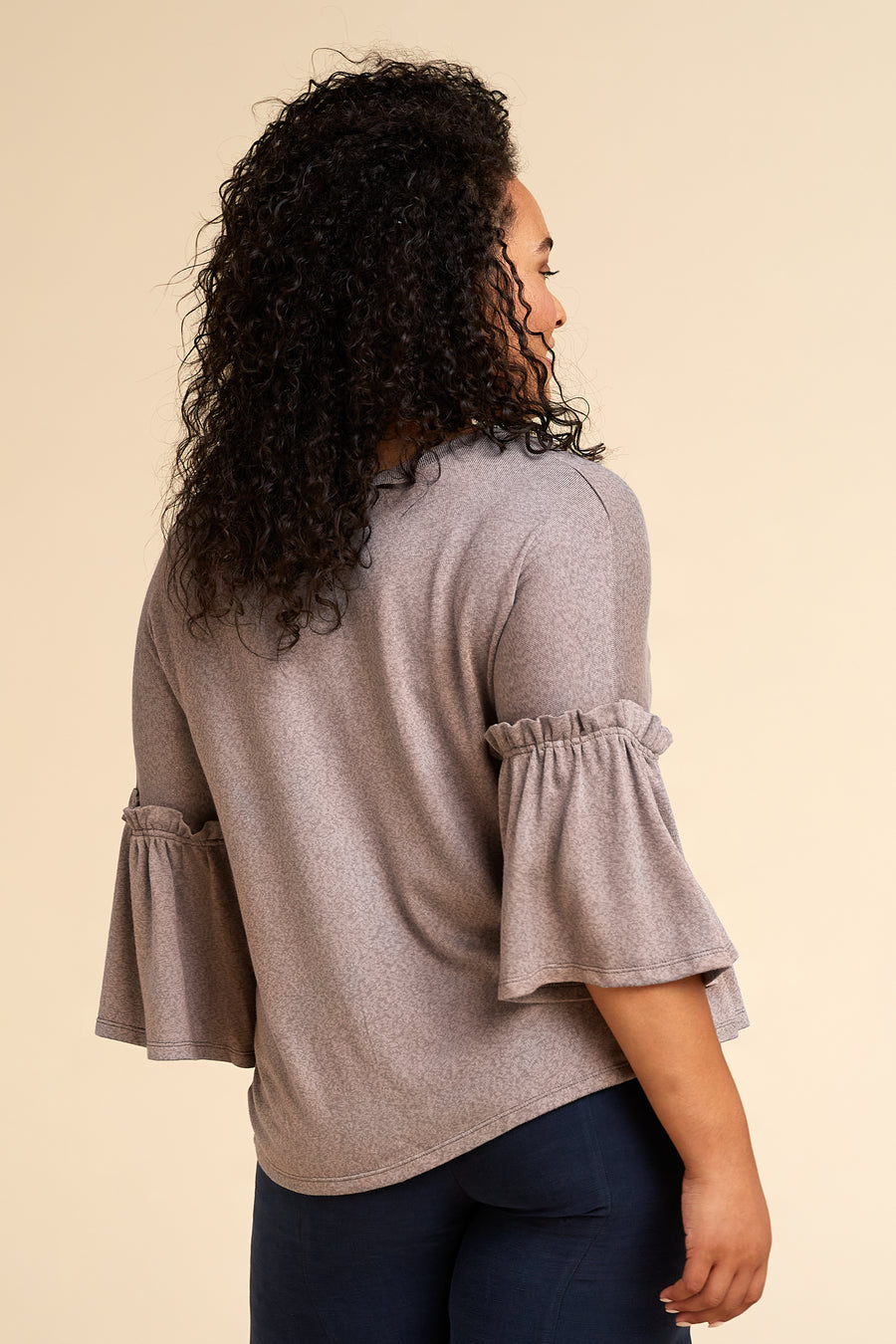 Model wearing Akala Clothing's sustainable Reversible Neckline Sweater in Mink color, size Large