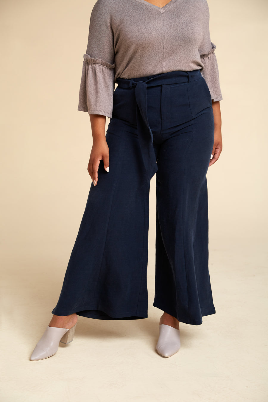 Front view of model wearing Akala Clothing's sustainable wide leg pant in Navy color, size Large