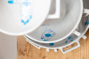colander with blue handpainting