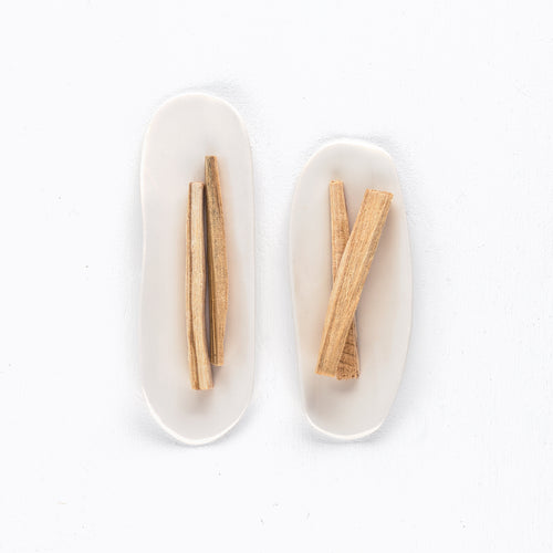 handmade dish with palo santo sticks