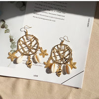 Fashion Shell Earrings Female Ocean Wind Conch Earrings Bohemian Metal Rattan Earrings