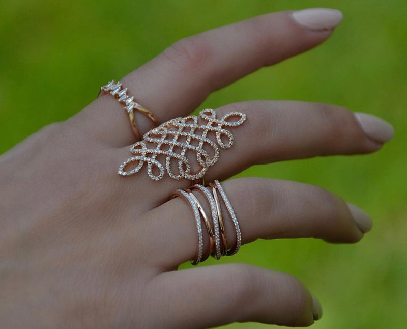 Double Intertwined Ring