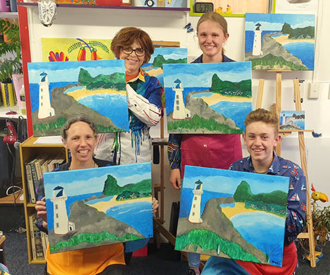 Happy painters with their finished Castlepoint paintings