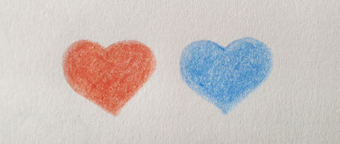 two hearts side by side drawn in colour pencil one red heart one blue heart