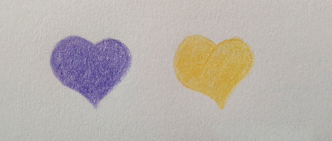 two hearts side by side drawn in colour pencil one purple heart one yellow heart