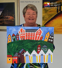 Online painter with her Oriental Bay painting