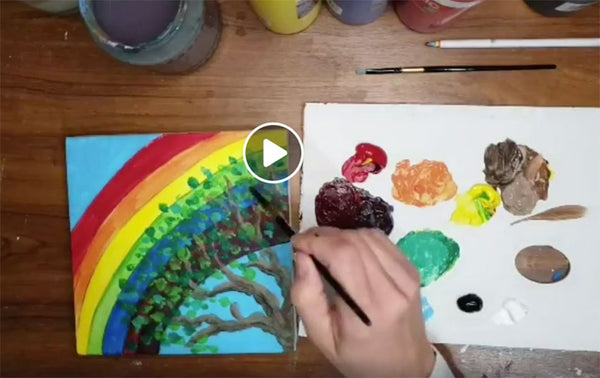 birds eye view of acrylic rainbow painting tutorial show artist painting square canvas with paint palette