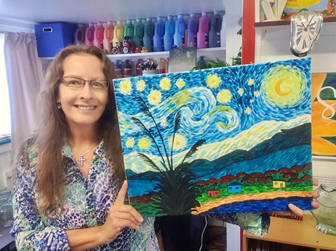 Silke founder of Heart for Art in studio with her Kiwi Starry Night painting