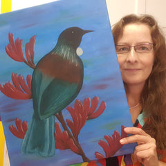 Silke from Heart for Art holding painting of Tui
