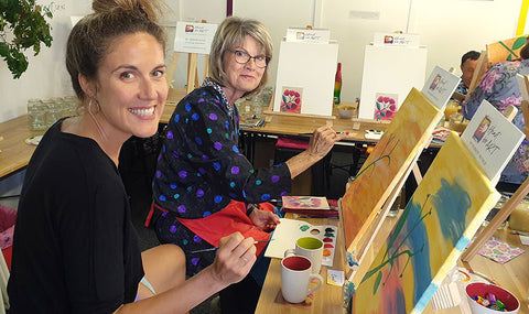 Happy women enjoying a step by step painting class in the Heart for Art studio