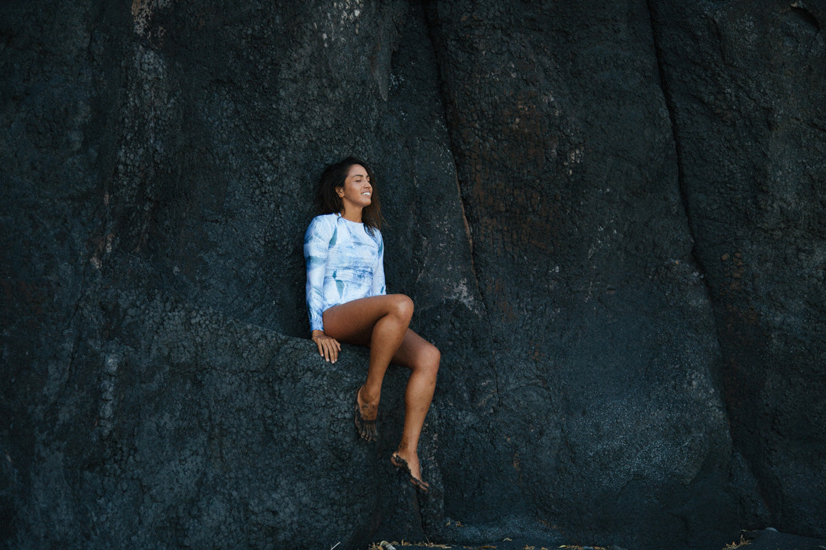 Mele Saili wears the Lynne rashguard on the black sand beaches in Maui.