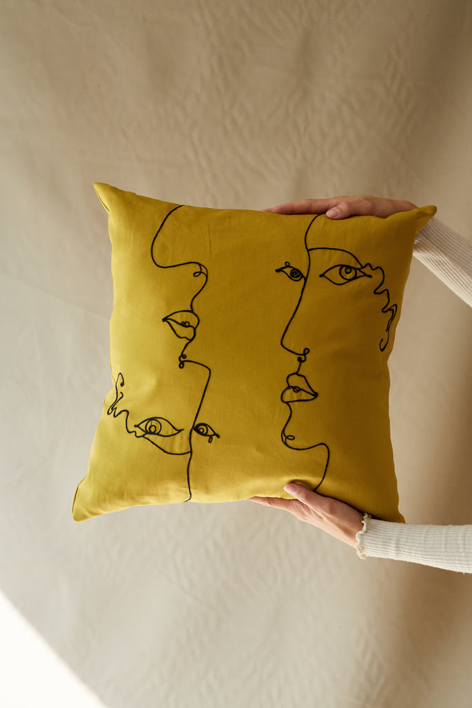 faces pillowcase in mustard