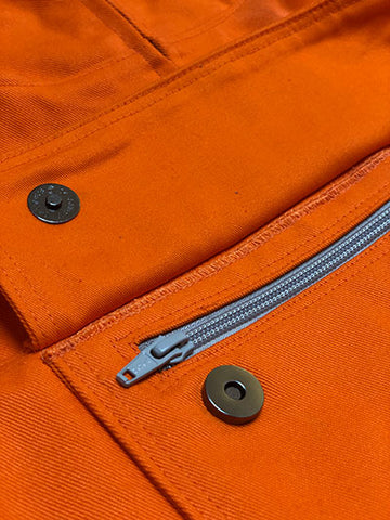 Close Up of North-West Expeditions Famous-to-Us Orange Anorak medium with zipper prototype