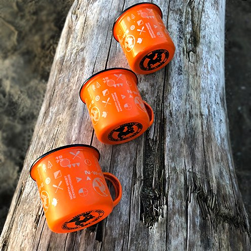 Trio of North-West Expeditions Campfire Mugs 8oz on a log
