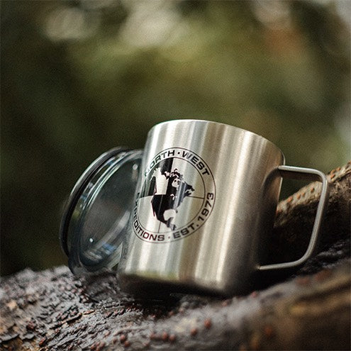 North-West Expeditions Insulated Camp Mug and lid on tree branch with black Logo