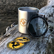 North-West Expeditions Insulated Camp Mug and lid engraved logo on log on beach log