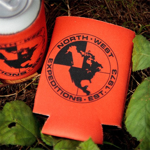 Close up North-West Expeditions Thin Koozie by tree