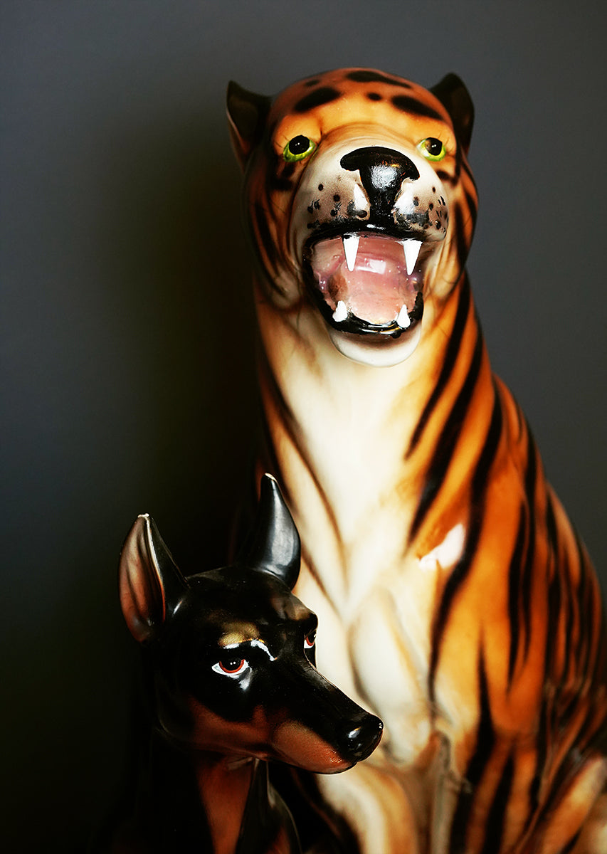 model poses with ceramic tiger