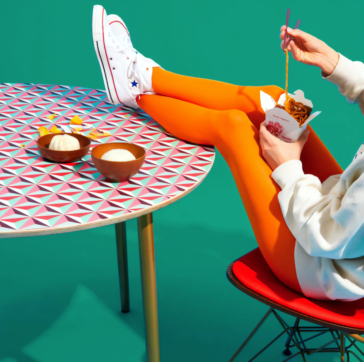 Legs on table eating noodles By Inside Weather