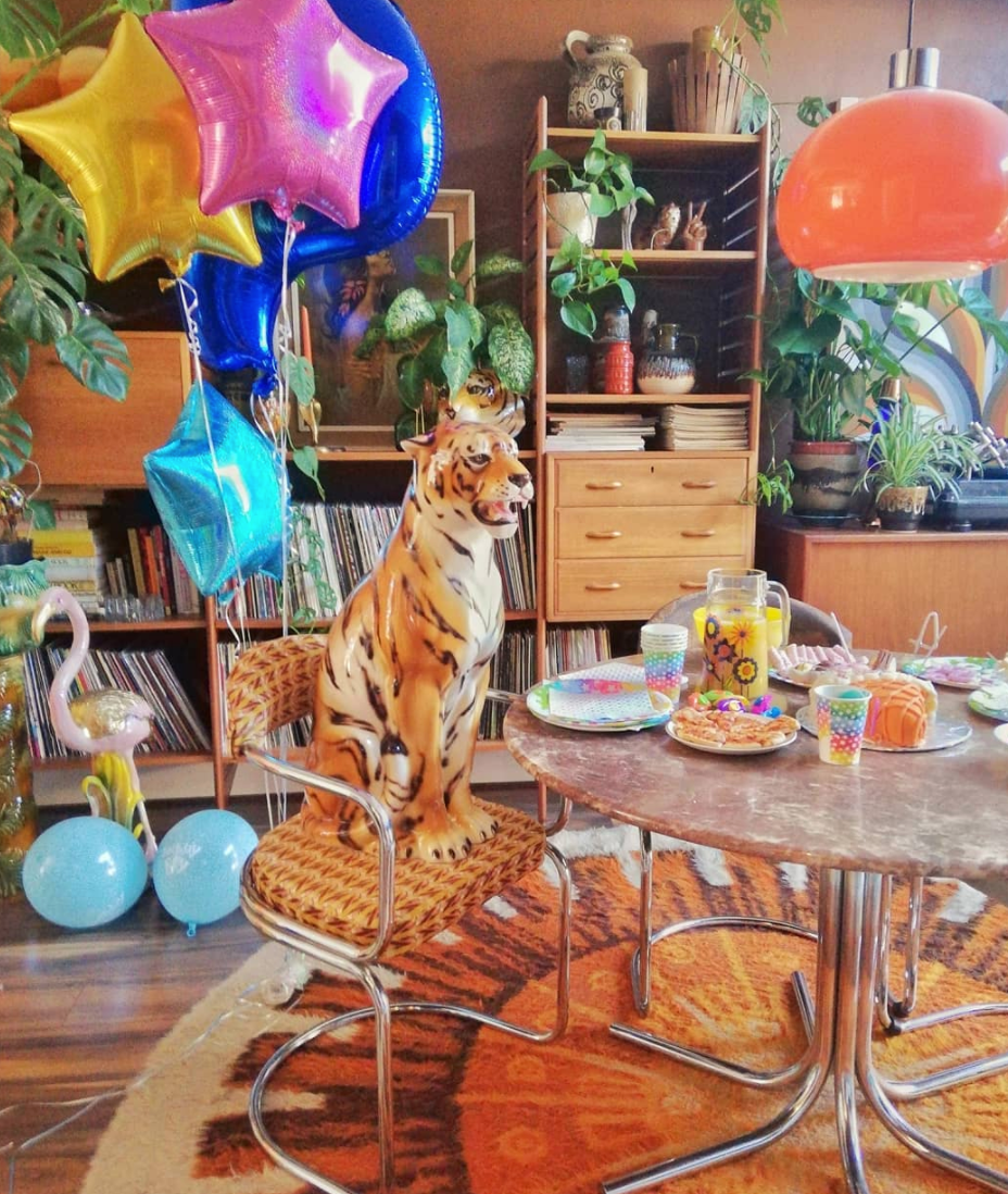 vintage ceramic tiger statue attends a tea party in a balloon filled room!