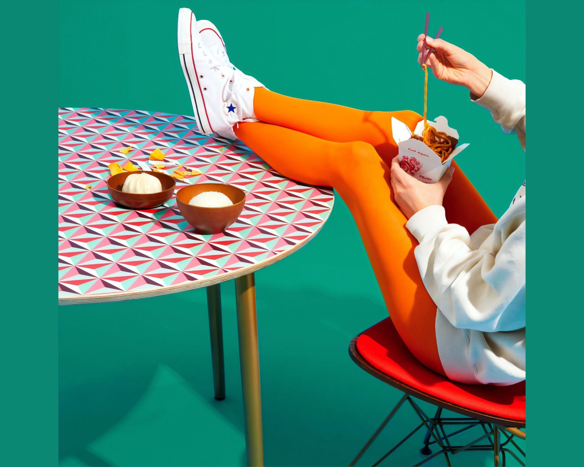 Image of girl with feet on the table eating take away food