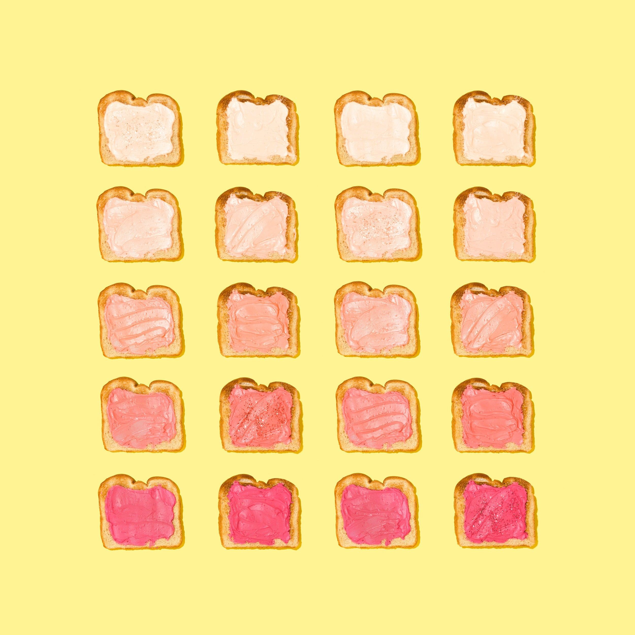 yellow background with rows of toast all with varying shades of pink spread