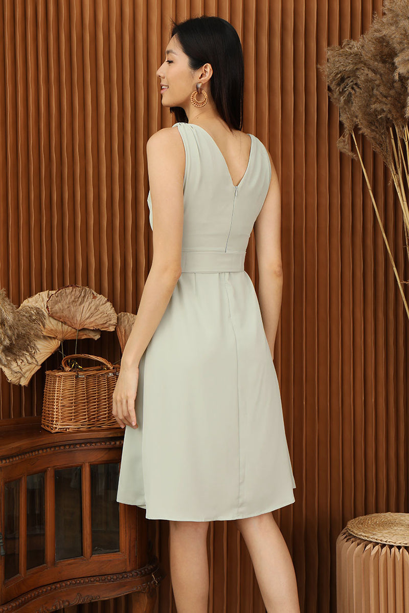 Athena Overlap Midi Dress (Sage) | Dear Lyla Singapore | Shop Online Women Fashion This greek goddess inspired dress features a v-neckline with a front overlap detail. Wear it with the detachable waist sash which comes with an exquisite buckle attached for a sophisticated look. Mesmerise the crowd in this stunning dress that is perfect for all occasion.  - Concealed back zip closure - Lined - Made of polyester - Functional side pockets  Available in Dusty Pink and Sage.