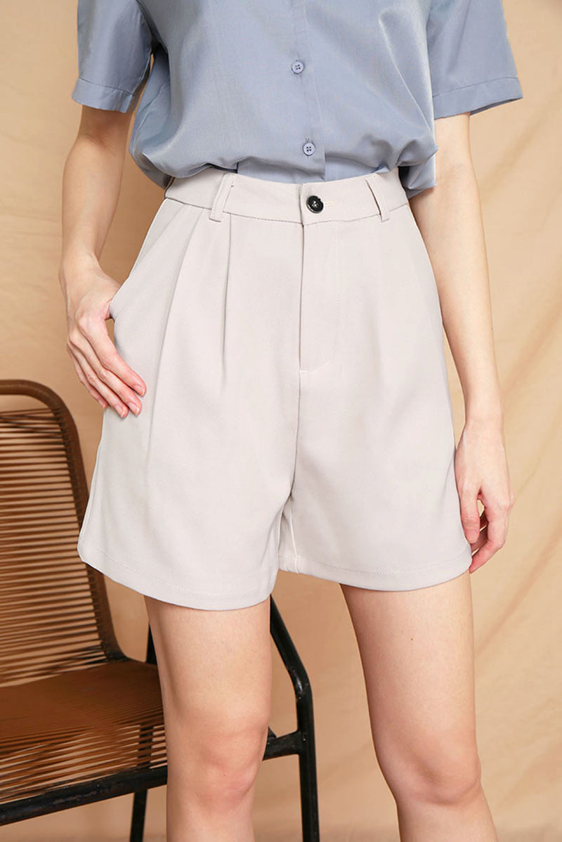 Brooklyn Tailored Shorts (Sand) l Dear Lyla Singapore l Shop Women Fashion A classic staple for your wardrobe, this shorts features a laid-back and slightly relaxed silhouette for that extra comfort yet not compromising on style. Pair it with your favourite basic tees for a casual look, dress it up with a dressy top or throw on a blazer for a semi-formal look - this versatile shorts offers endless styling possibilities.  Pair it with our Freda Oversized Button Down Shirt (Dusty Blue) to complete the look.