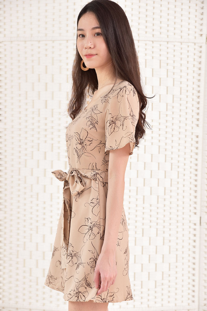 Carly Floral Dress #MadeByDearLyla (Sand Floral)  | Dear Lyla Singapore | Shop Women Fashion A simple versatile floral dress for everyday wear. We love the minimalistic yet artistic vibes of the floral abstract prints. Features a square neckline to show off your collar bones and flattering flutter sleeves. Comes with a detachable sash which you can tie at your waist or wear as a headband for a trendy vintage look.   - Concealed back zip closure  - Lined   Exclusively manufactured by Dear Lyla.