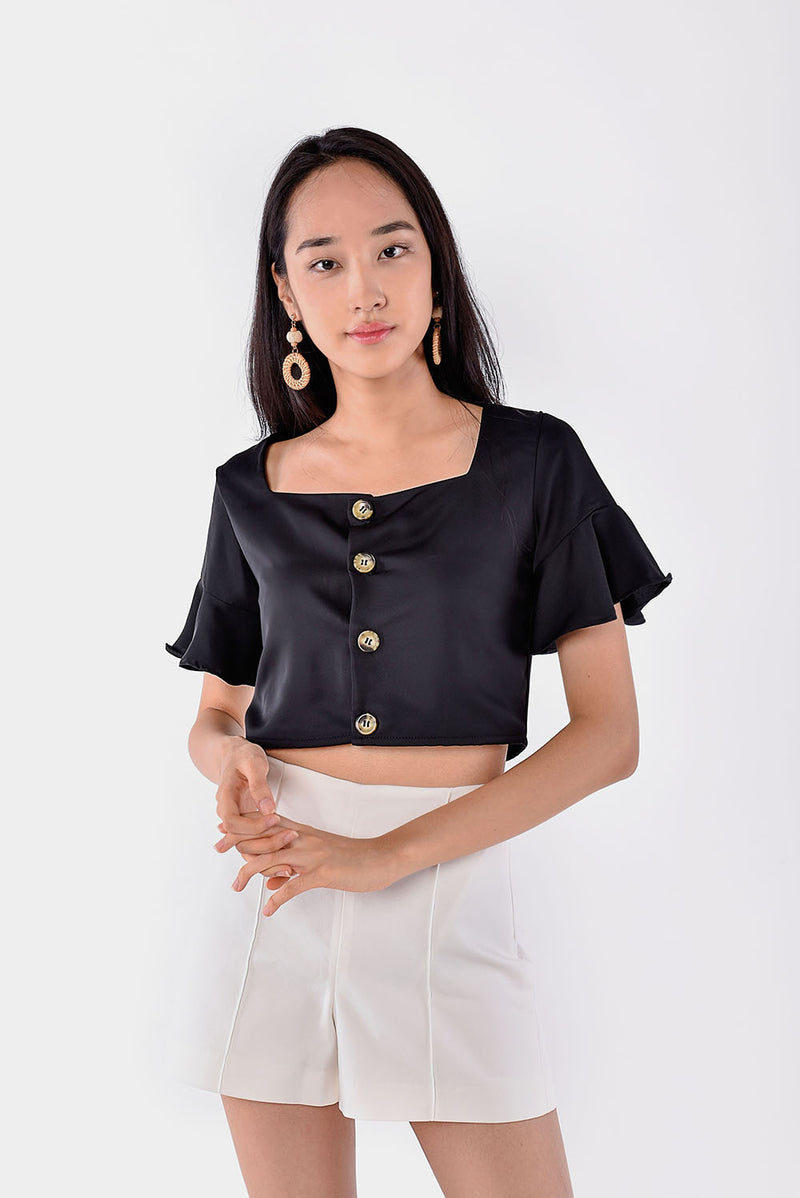 Cherie Flutter Sleeve Top (Black) l Dear Lyla Singapore l Shop Online Women Fashion This top is a simple yet flattering piece with its flutter sleeves and square neckline. Pair this crop top with high-waisted bottoms.  - Functional buttons - Lined - Made of soft polyester  Available in Black and Navy.  Exclusively manufactured by Dear Lyla.